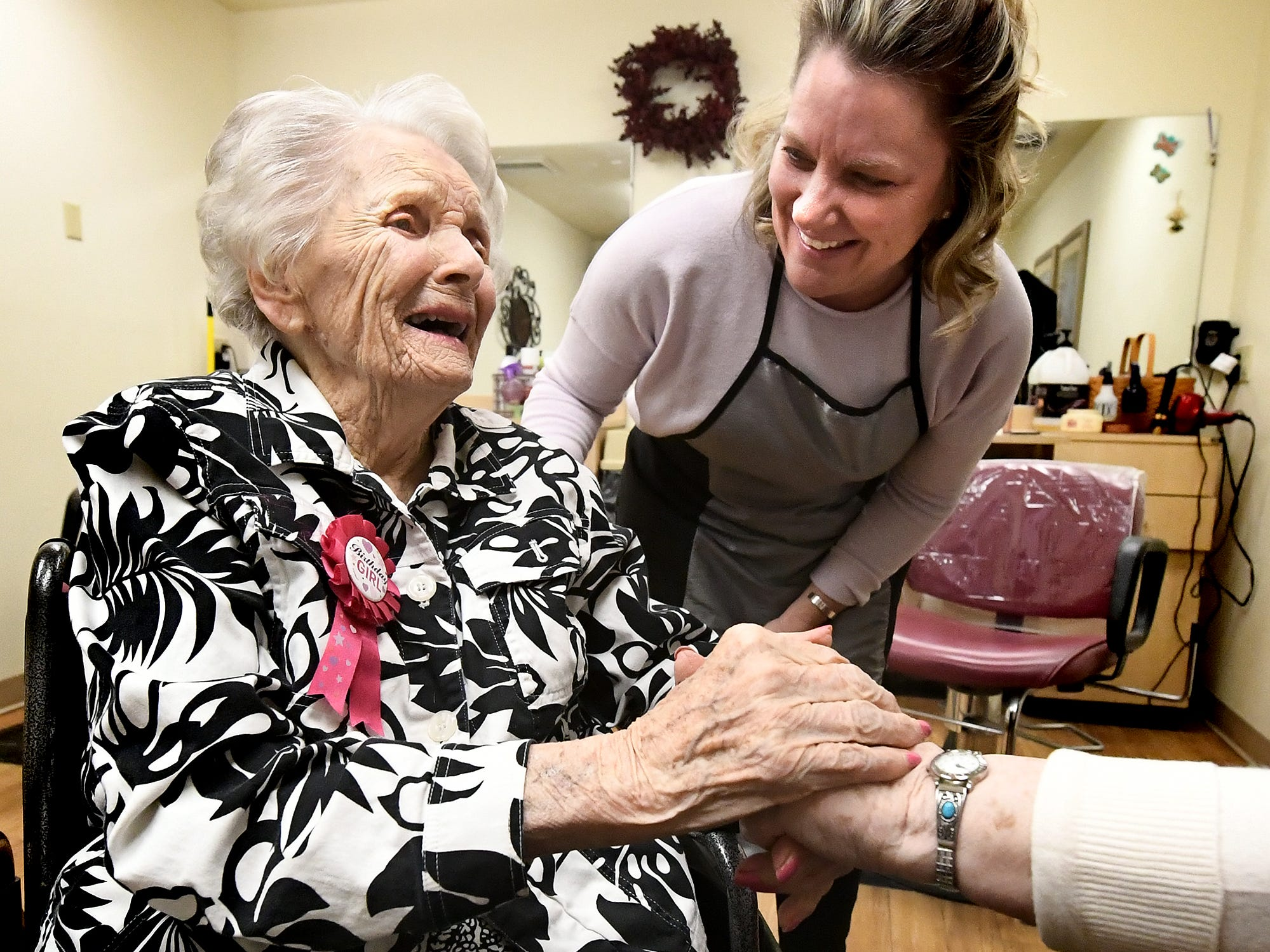 Hairdresser Vicki Zarilla watches as Ruth Kohler gets a birthday wish from a fellow resident, right, after Ruth got her hair done by in preparation of celebrating her 104th birthday at Senior Commons at Powder Mill where she is a resident Friday, Feb. 1, 2019. According to Commons staff, she is the oldest resident to have lived there. Bill Kalina photo