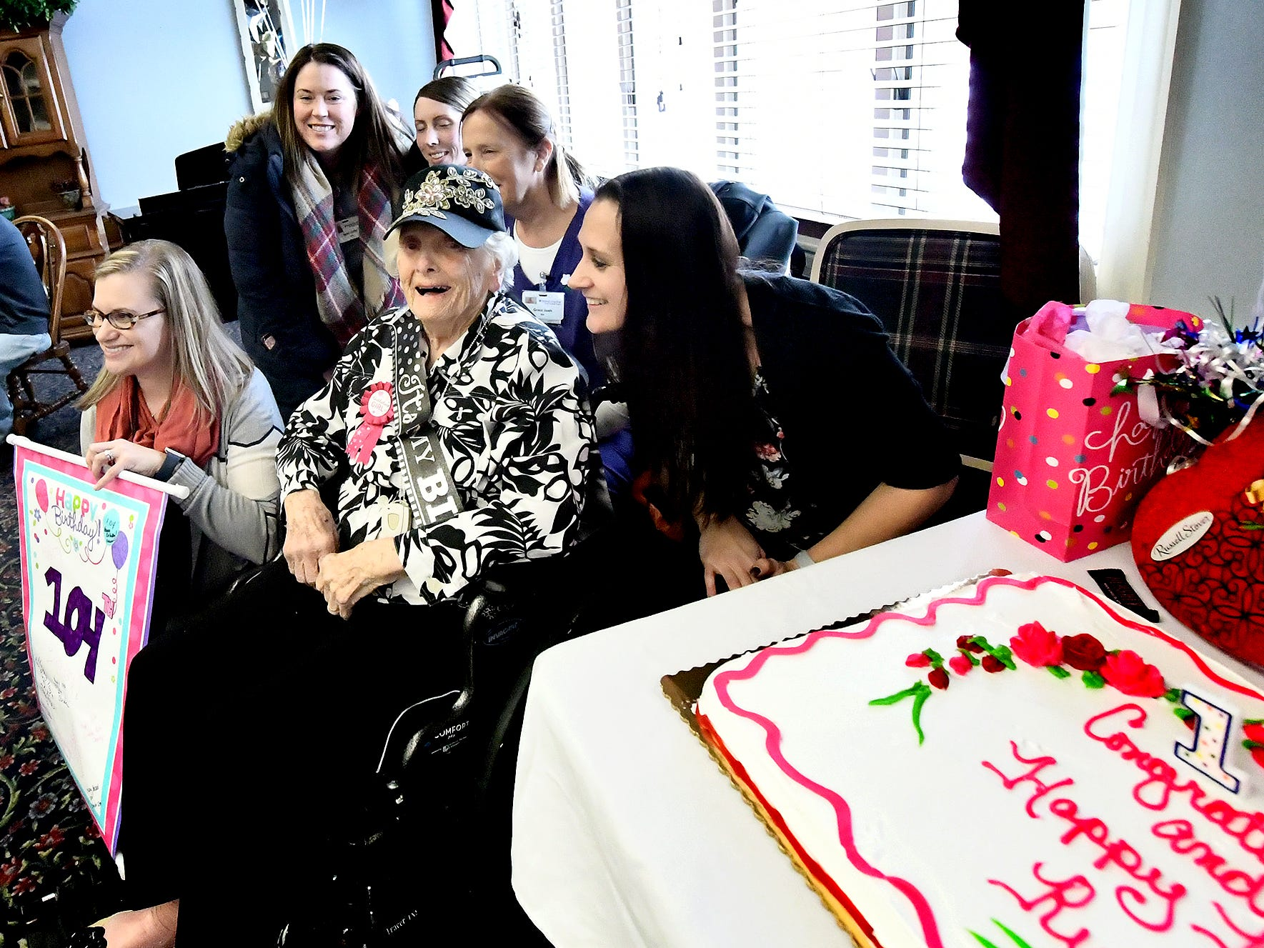 Ruth Kohler is surrounded by xxxxx staff while celebrating her 104th birthday at Senior Commons at Powder Mill where she is a resident Friday, Feb. 1, 2019. According to Commons staff, she is the oldest resident to have lived there. Bill Kalina photo