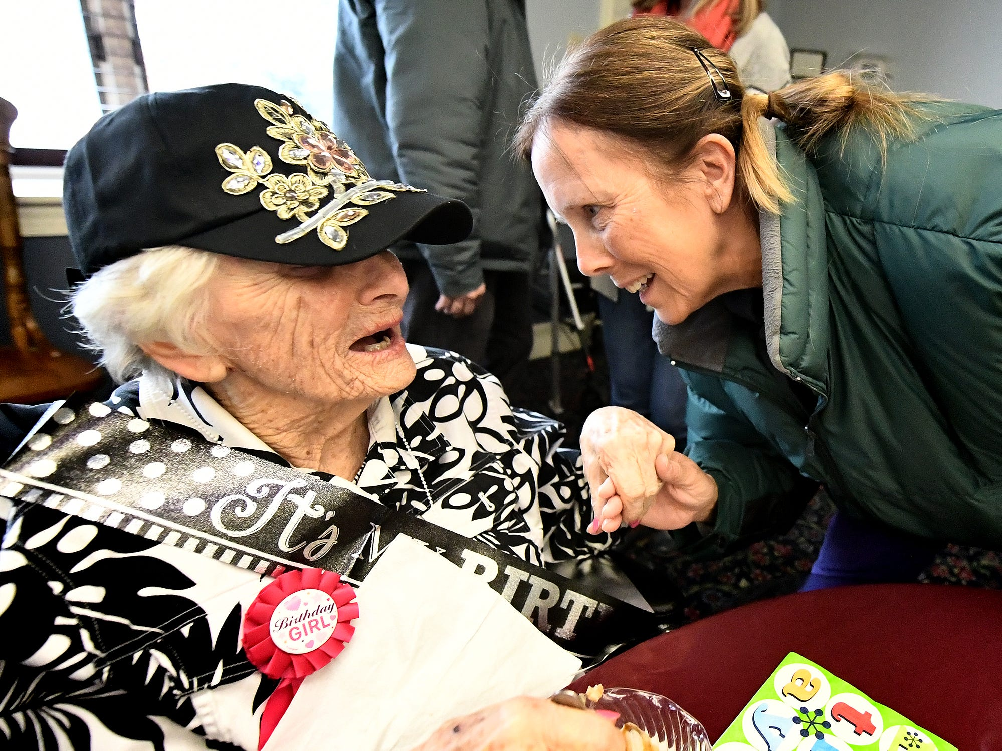 Ruth Kohler gets a birthday greeting while celebrating her 104th birthday at Senior Commons at Powder Mill where she is a resident Friday, Feb. 1, 2019. According to Commons staff, Ruth is the oldest resident to have lived there. Bill Kalina photo