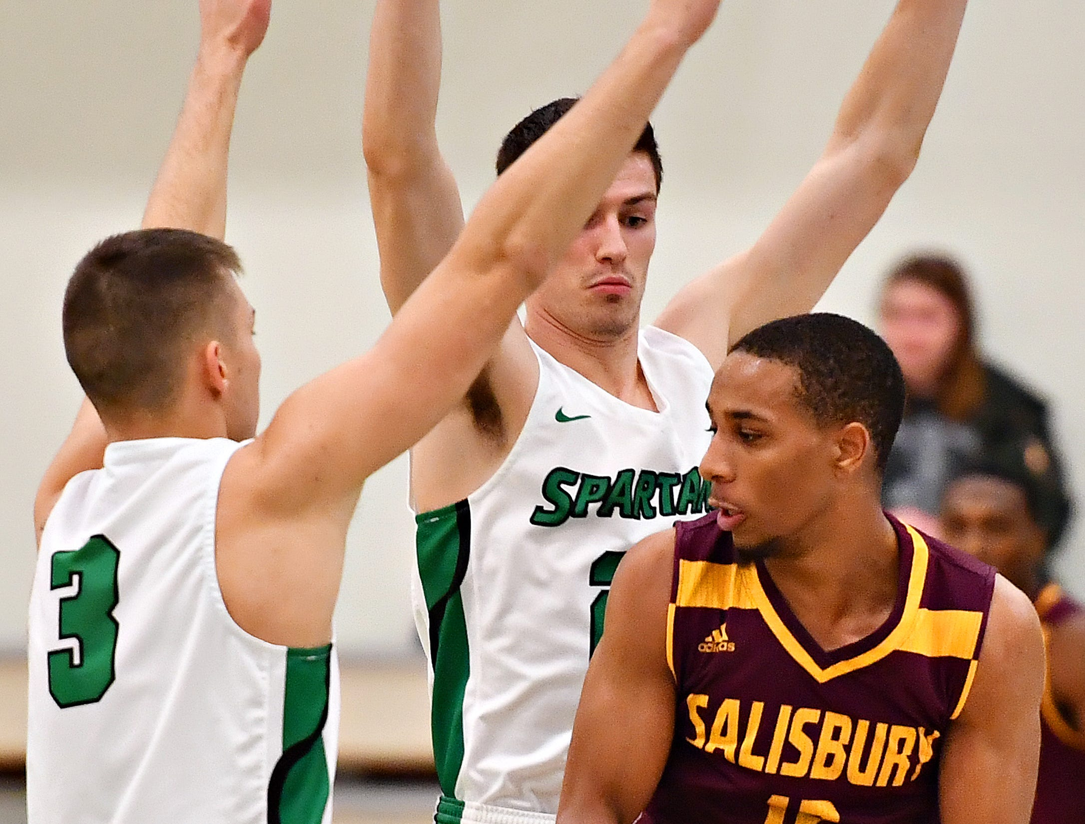 York College's Sean Kelly, left, and Darin Gordon, center, work to box in Salisbury's Mike Ward during men's basketball action at Grumbacher Sport and Fitness Center at York College of Pennsylvania in Spring Garden Township, Wednesday, Feb. 6, 2019. Dawn J. Sagert photo