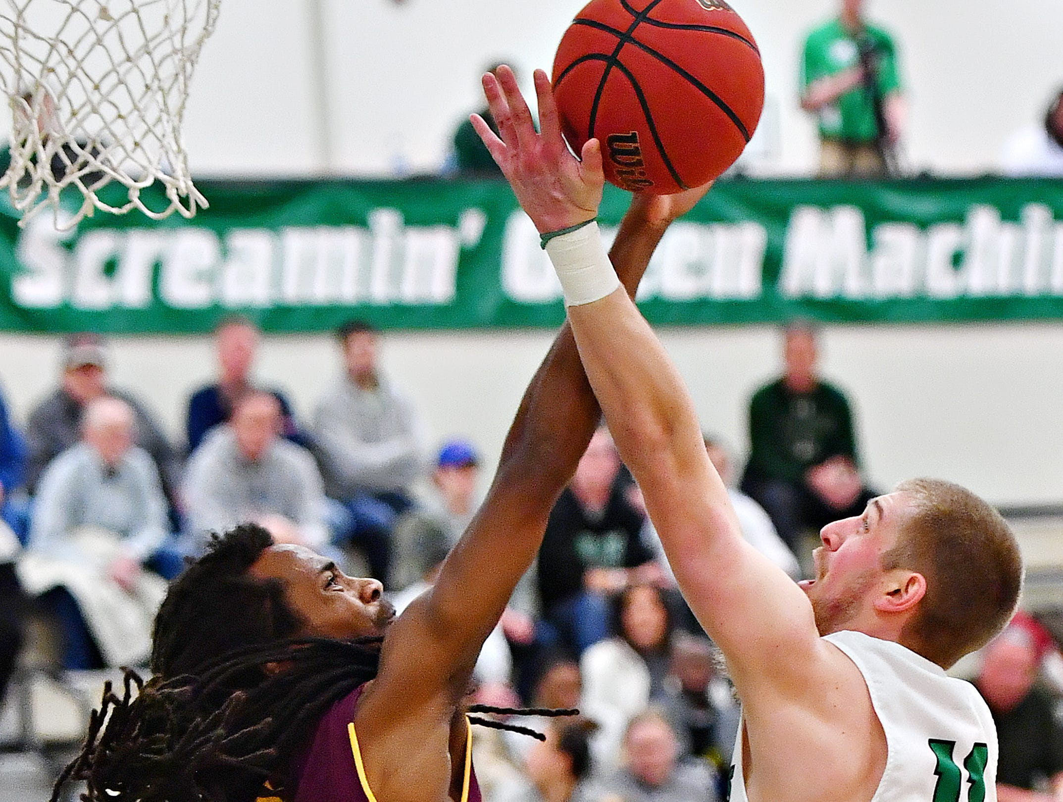 York College's Mike Frauenheim, right, takes the ball to the basket while Salisbury's Marquis Roberson defends during men's basketball action at Grumbacher Sport and Fitness Center at York College of Pennsylvania in Spring Garden Township, Wednesday, Feb. 6, 2019. Dawn J. Sagert photo
