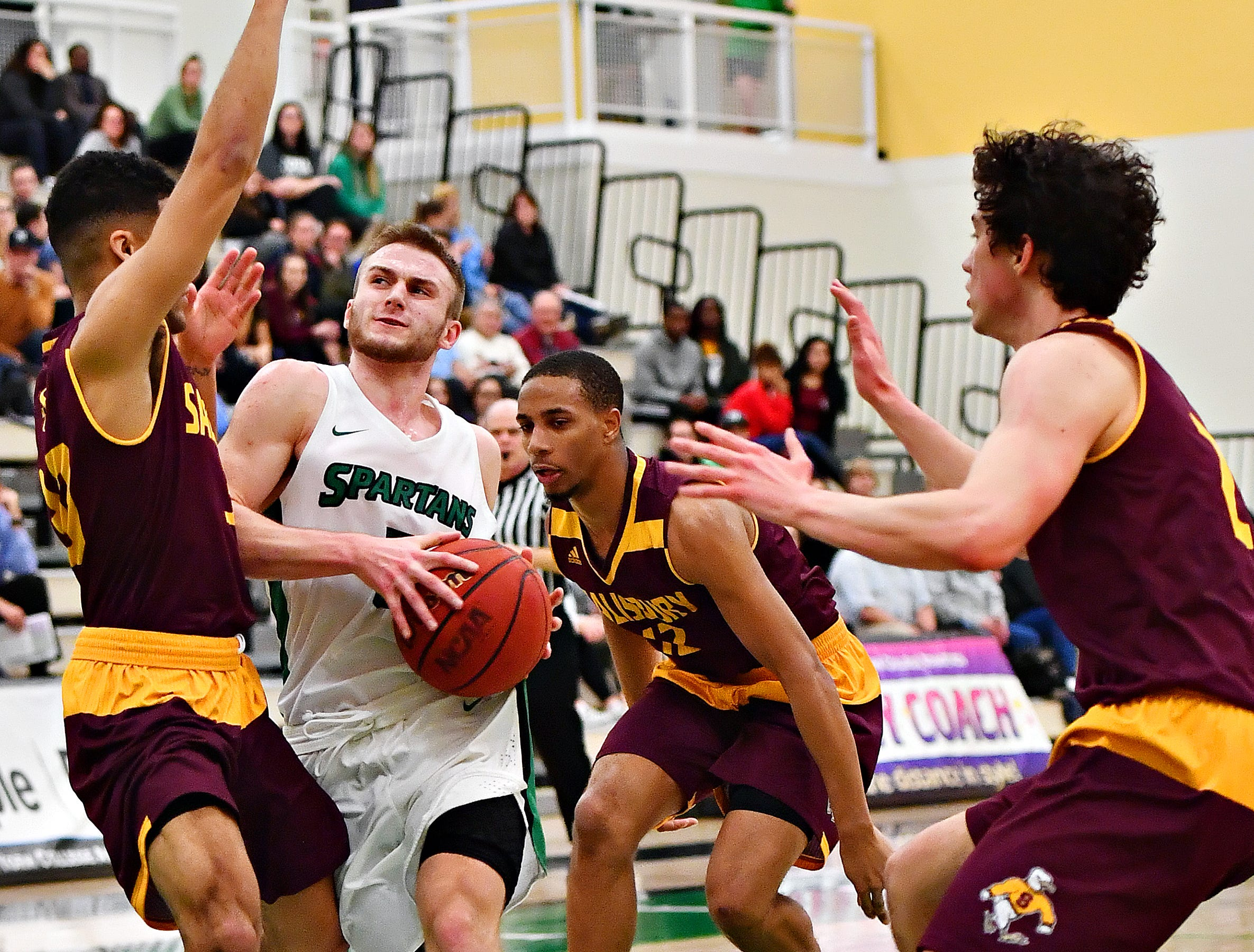 York College's Jared Wagner, center, works to get past Salisbury's Braedon Dorsey, left, and Mike Ward during men's basketball action at Grumbacher Sport and Fitness Center at York College of Pennsylvania in Spring Garden Township, Wednesday, Feb. 6, 2019. Dawn J. Sagert photo