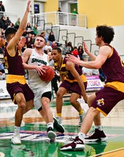 York College's Jared Wagner, center, is seen here in action last season. Wagner is a Central York High School graduate. He was recently named to the National Association of Basketball Coaches Honors Court, honoring academic and athletic achievement.