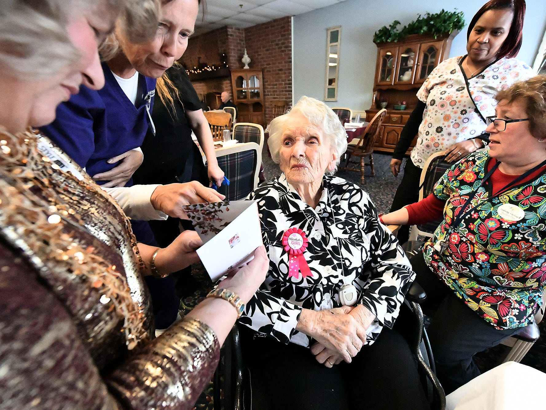 Ruth Kohler is surrounded by well-wishers while celebrating her 104th birthday at Senior Commons at Powder Mill where she is a resident Friday, Feb. 1, 2019. According to Commons staff, she is the oldest resident to have lived there. Bill Kalina photo