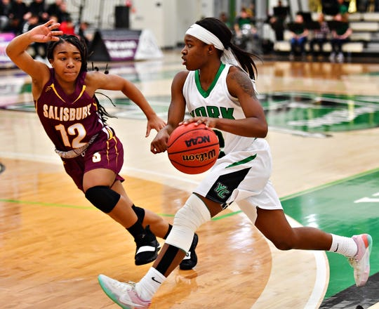 York College's Debria Hendricks, right, pushes past Salisbury's Amber Onyekwere during women's basketball action at Grumbacher Sport and Fitness Center at York College of Pennsylvania in Spring Garden Township, Wednesday, Feb. 6, 2019. York College would win the game 72-62. Dawn J. Sagert photo