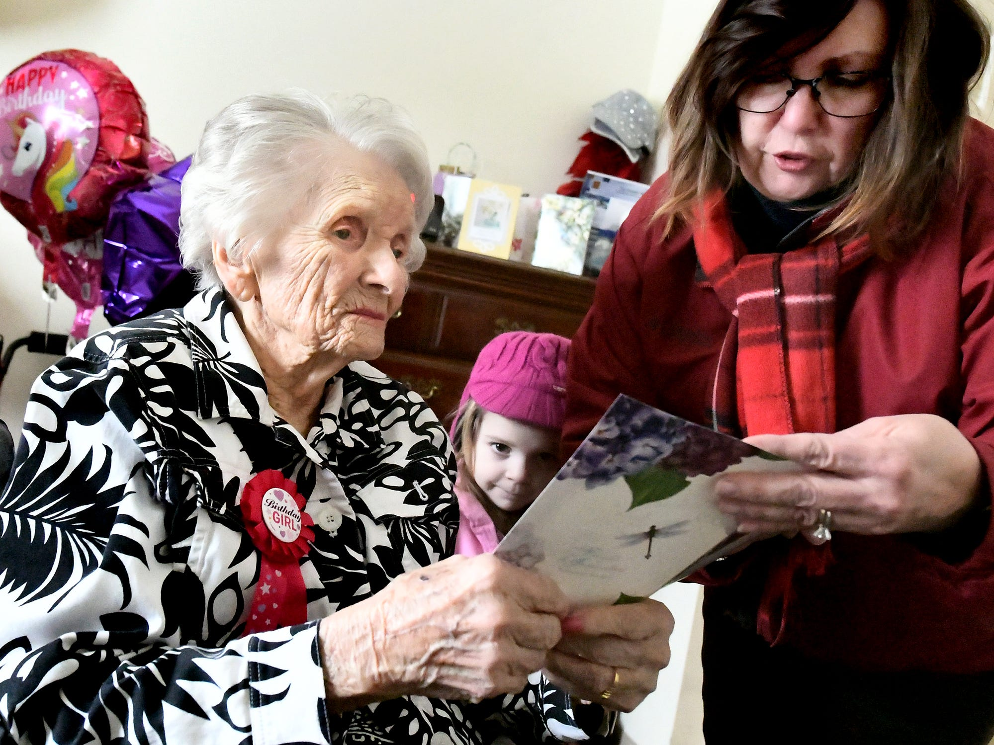 Stephanie Abel reads a birthday card she got for her grandmother Ruth Kohler along with Ruth's great-granddaughter Kahleigh Abel, 4, on her 104th birthday at Senior Commons at Powder Mill where Ruth is a resident Friday, Feb. 1, 2019. According to Senior Commons staff, she is the oldest resident to have lived there. Bill Kalina photo