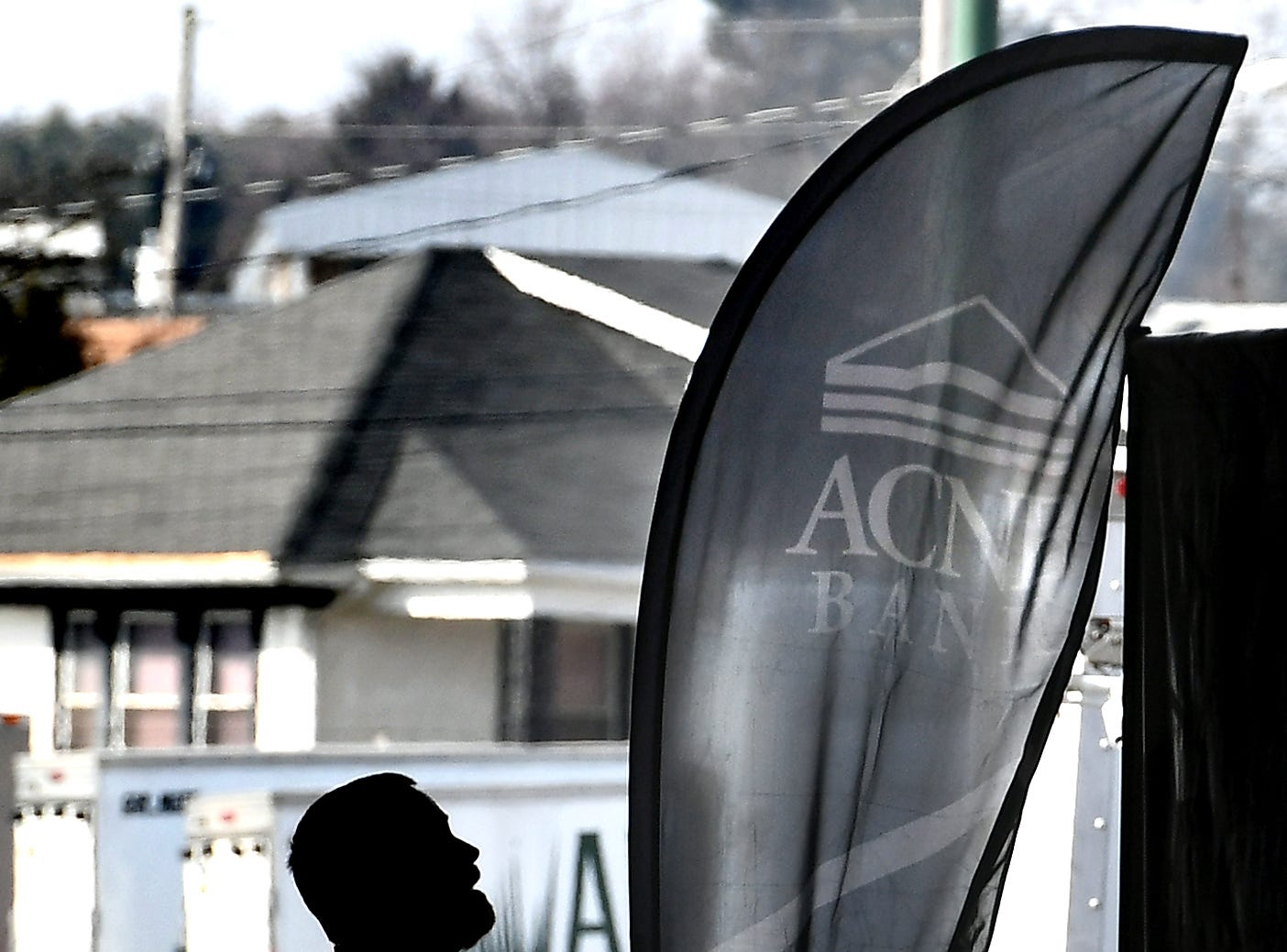 ACNB Bank employees Kevin Stultz erects a feather banner while he and Denise Descheemaeker, left, assemble the company's display at the 51st Annual Home & Garden Show at The York Expo Center Arena Thursday, Feb. 7, 2019. The show runs Feb. 8-10. The hours are Friday 1 p.m. to 8 p.m.; Saturday 9 a.m. to 7 p.m and Sunday 10 A.m. to 3 p.m. Admission for adults is $8 and kids under 18 get in free. Bill Kalina photo