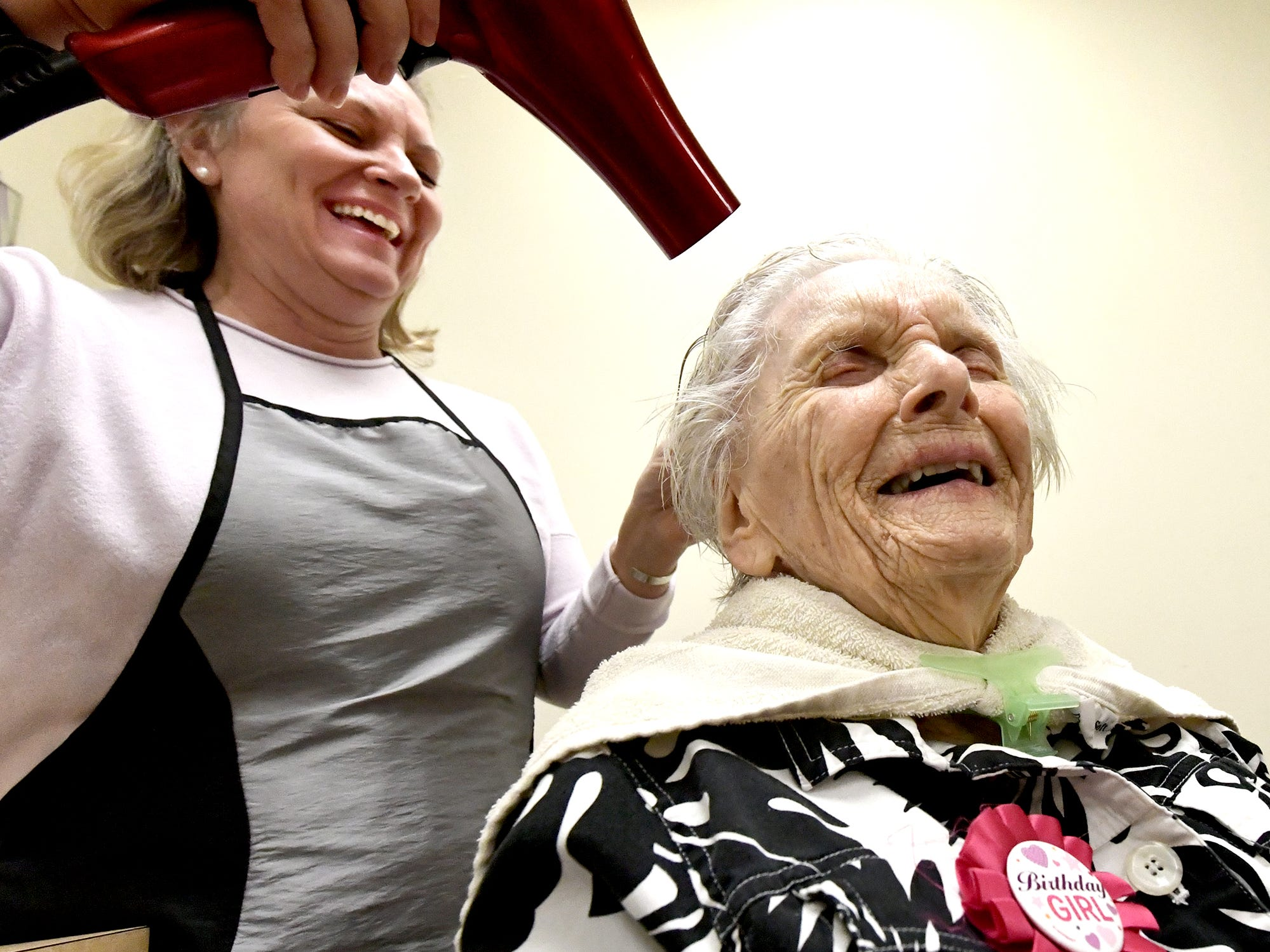 Hairdresser Vicki Zarilla and Ruth Kohler share a laugh as Ruth gets her hair done by in preparation of celebrating her 104th birthday at Senior Commons at Powder Mill where she is a resident Friday, Feb. 1, 2019. According to Commons staff, she is the oldest resident to have lived at the York Township senior care facility. Bill Kalina photo