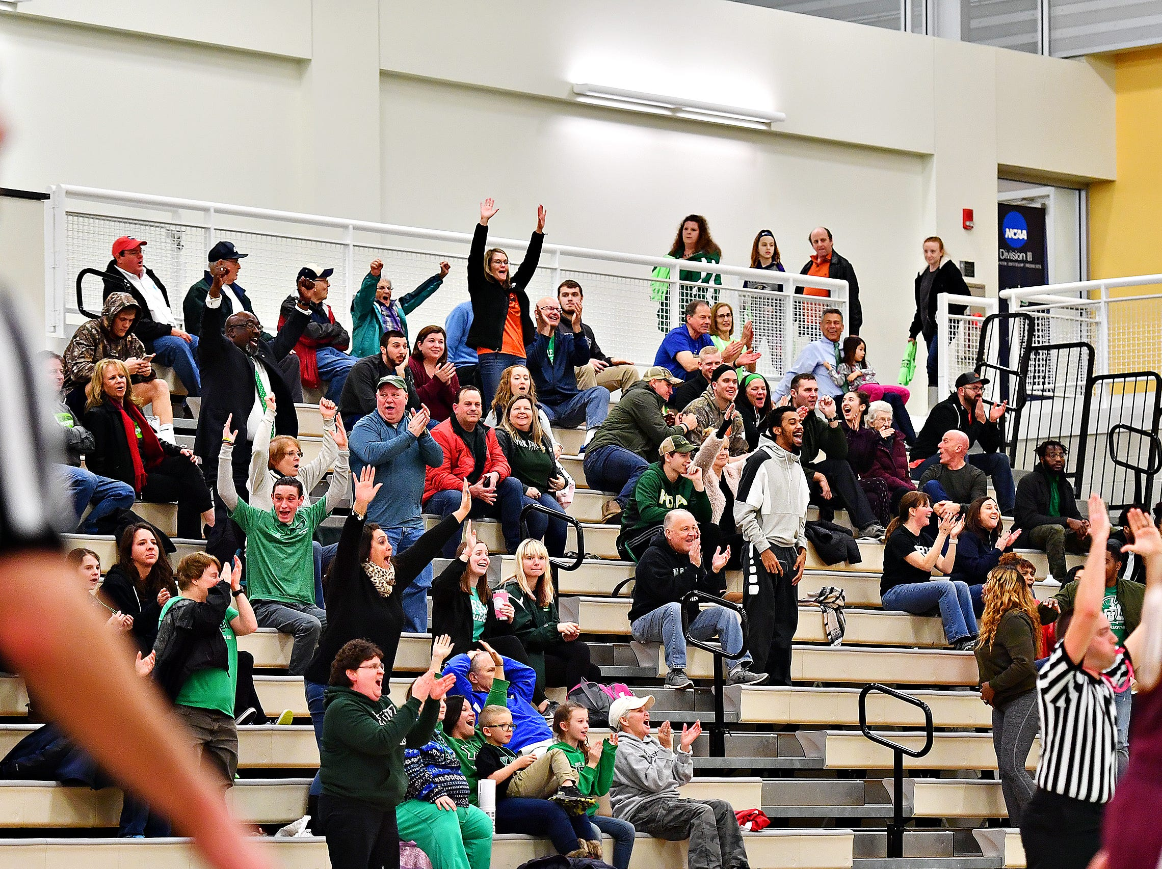 Fans react as York College's Debria Hendricks scores on the buzzer at halftime during women's basketball action against Salisbury at Grumbacher Sport and Fitness Center at York College of Pennsylvania in Spring Garden Township, Wednesday, Feb. 6, 2019. Dawn J. Sagert photo