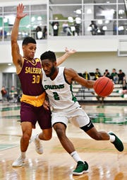 York College's Jason Bady, seen here at right in a file photo, is the Capital Athletic Conference Men's Basketball Player of the Year.