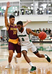York College's Jason Bady, right, works to get past Salisbury's Braedon Dorsey during men's basketball action at Grumbacher Sport and Fitness Center at York College of Pennsylvania in Spring Garden Township, Wednesday, Feb. 6, 2019. Dawn J. Sagert photo