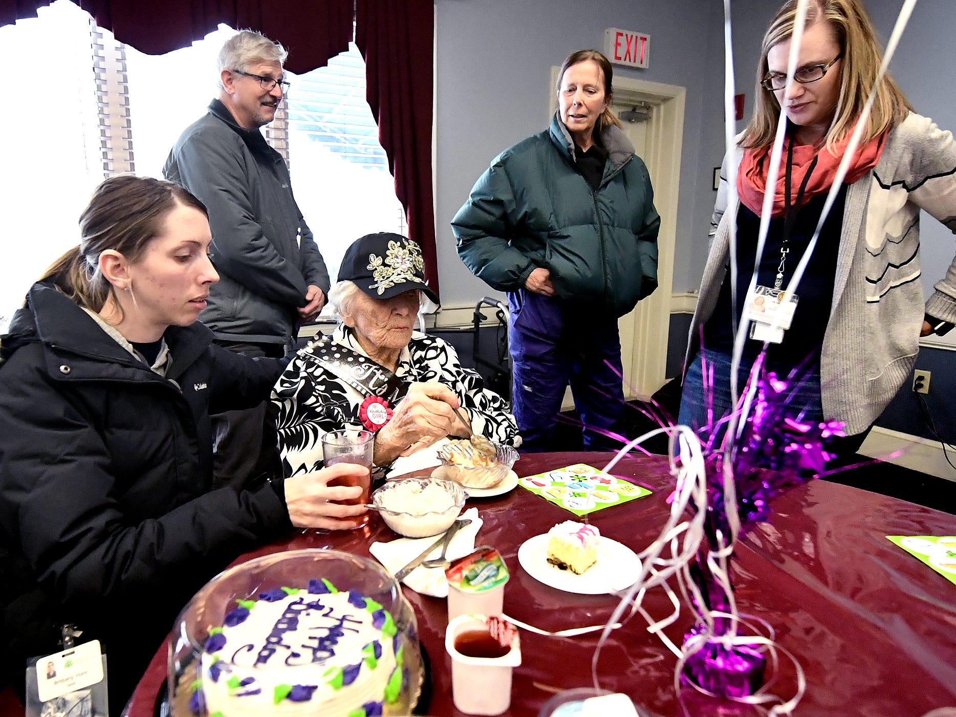 Memorial White Rose Home Health and Hospice aide Brittany Hare, left, and other staff surround Ruth Kohler during Ruth's 104th birthday celebration at Senior Commons at Powder Mill where Ruth is a resident Friday, Feb. 1, 2019. According to Senior Commons staff, she is the oldest resident to have lived there. Bill Kalina photo