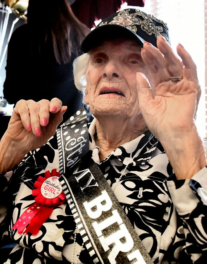 Ruth Kohler waves to fellow residents celebrating her 104th birthday at Senior Commons at Powder Mill where Ruth is a resident Friday, Feb. 1, 2019. According to Senior Commons staff, she is the oldest resident to have lived there. Bill Kalina photo