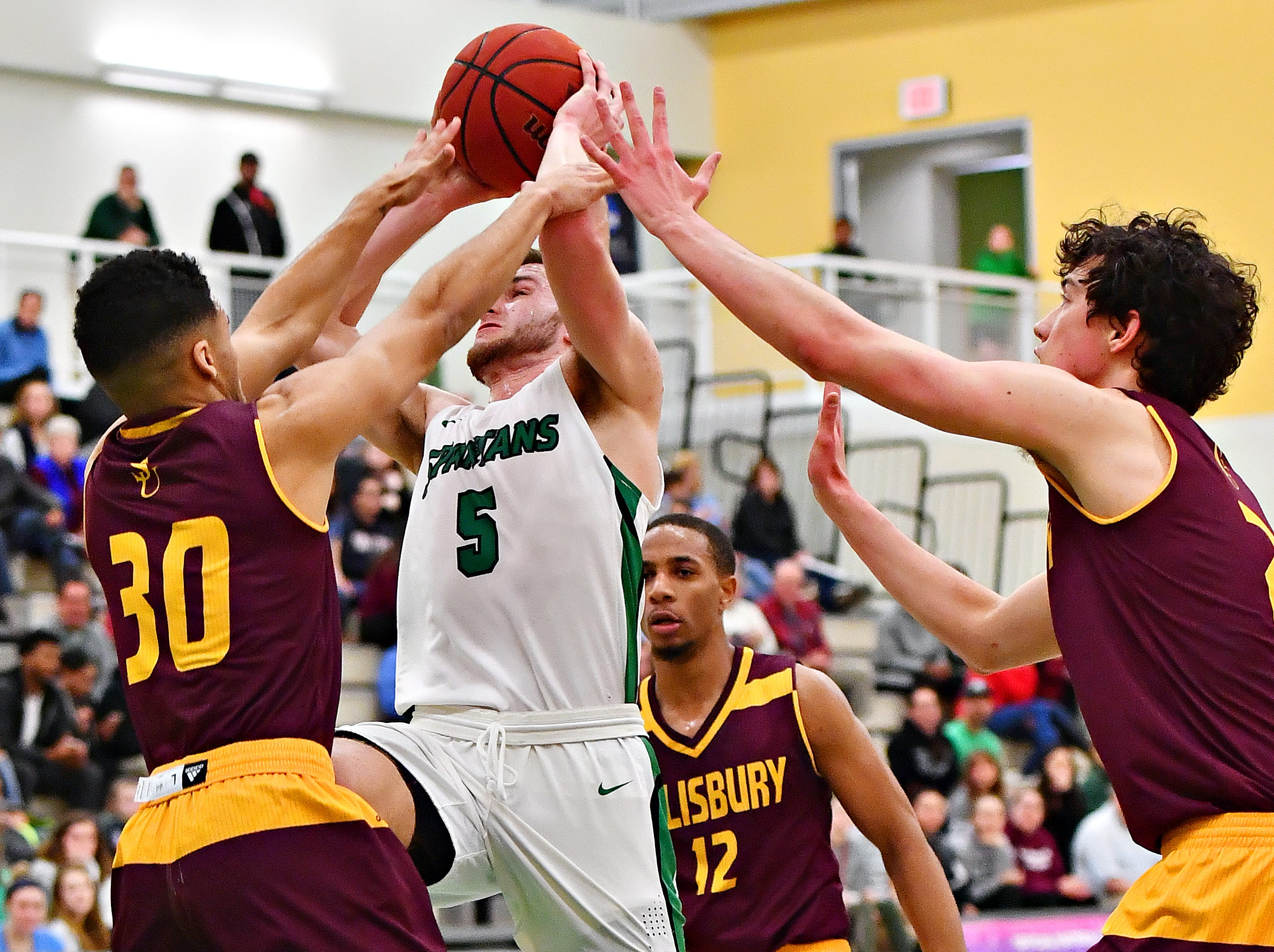 York College's Jared Wagner, second from left, gets past Salisbury's Braedon Dorsey, left, Lucas Martin, right, and Mike Ward to score during men's basketball action at Grumbacher Sport and Fitness Center at York College of Pennsylvania in Spring Garden Township, Wednesday, Feb. 6, 2019. Dawn J. Sagert photo