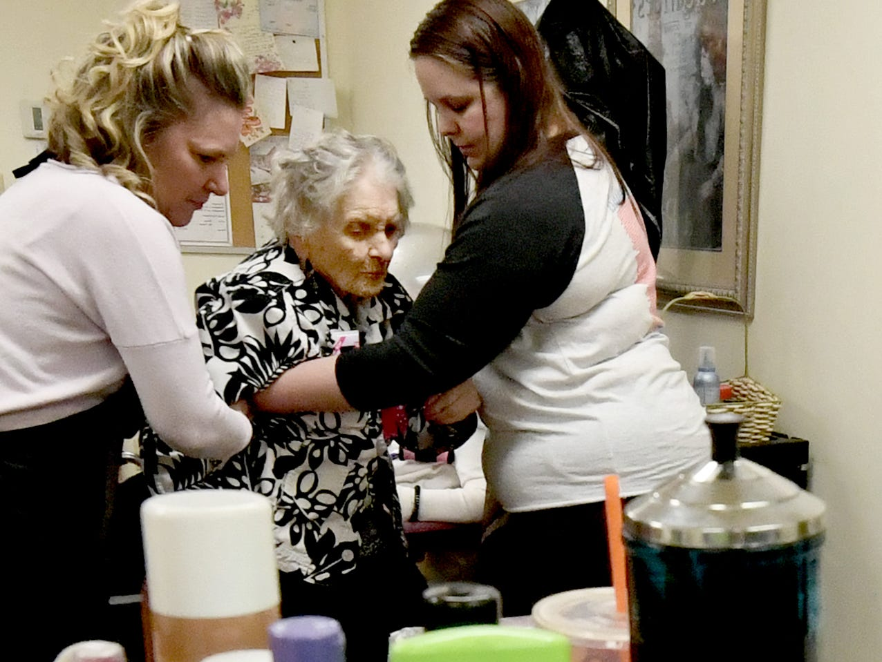 Hairdresser Vicki Zarilla, left, and physical therapist Tiffany McSherry seat Ruth Kohler for a makeover before celebrating her 104th birthday at Senior Commons at Powder Mill where she is a resident Friday, Feb. 1, 2019. According to Commons staff, she is the oldest resident to have lived there. Bill Kalina photo