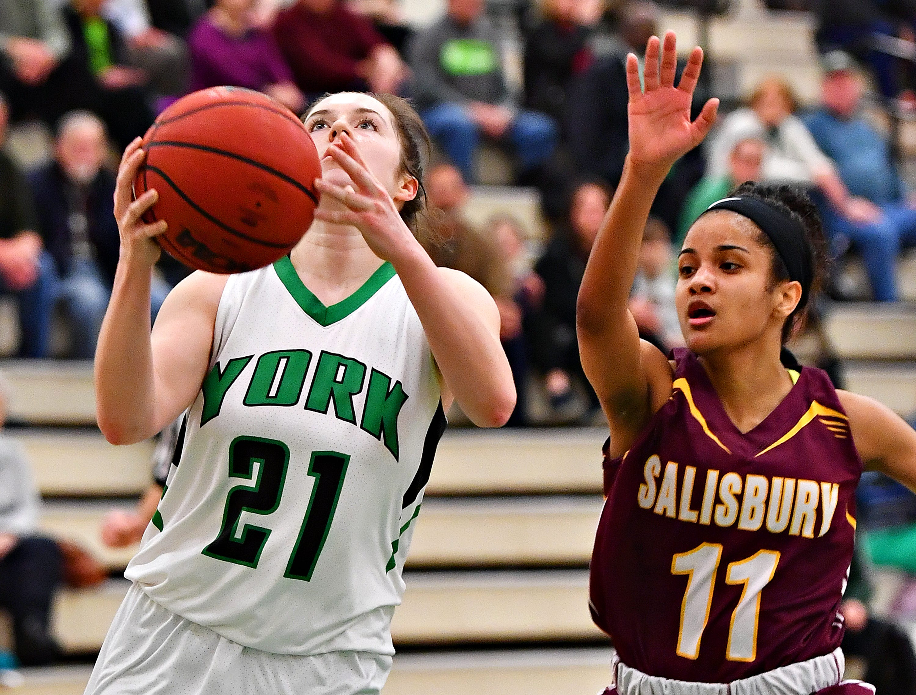 York College's Kayla Ferris, left, takes the ball to the basket while Salisbury's Jada Welbon defends during women's basketball action at Grumbacher Sport and Fitness Center at York College of Pennsylvania in Spring Garden Township, Wednesday, Feb. 6, 2019. Dawn J. Sagert photo