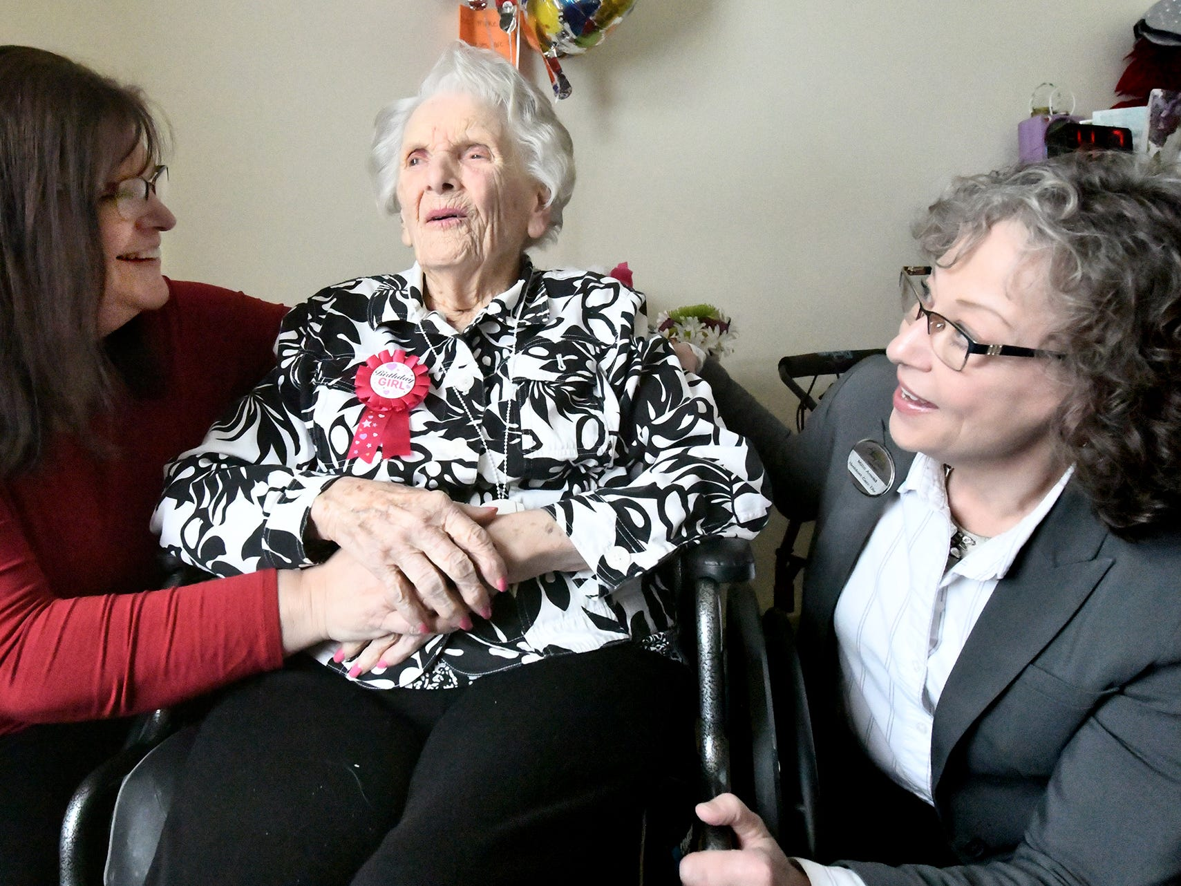 Senior Commons at Powder Mill Executive Director Winona Kissinger, left, and resident Care Director Millie Arnold talks with Ruth Kohler before her 104th birthday celebration Friday, Feb. 1, 2019. According to Commons staff, she is the oldest resident to have lived there. Bill Kalina photo