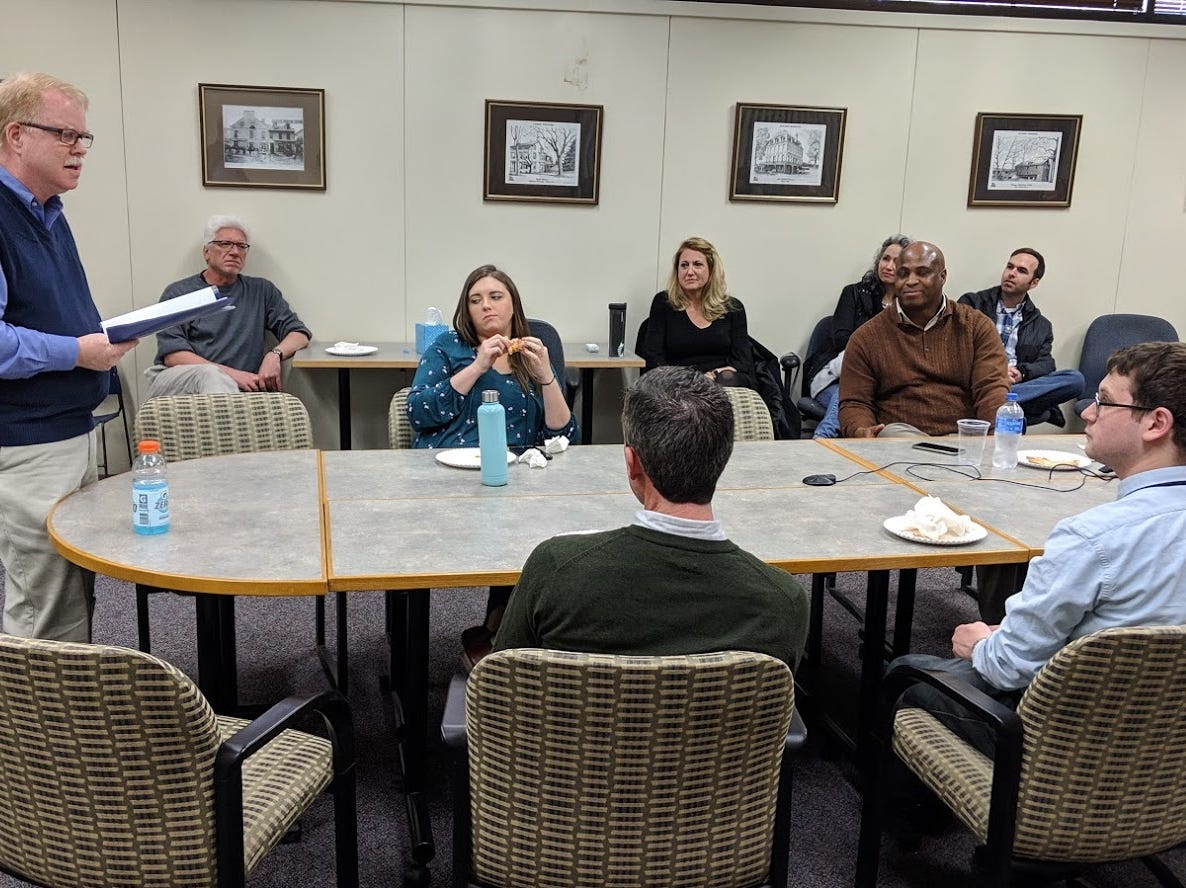YDR Editor Jim McClure briefs the staff on the newsroom's recent successes, before breaking the surprise news that he plans to retire April 1.