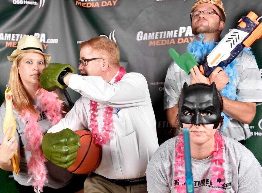 Jim McClure, second from left, wasn't all serious work. Here he is, sporting hulk hands, with Lyzz Jones, Evening Sun news director, left; and former YDR Sports staffers Teddy Feinberg, top right , and Jess Sprenkle, at GameTimePA's Media Day a few years ago.