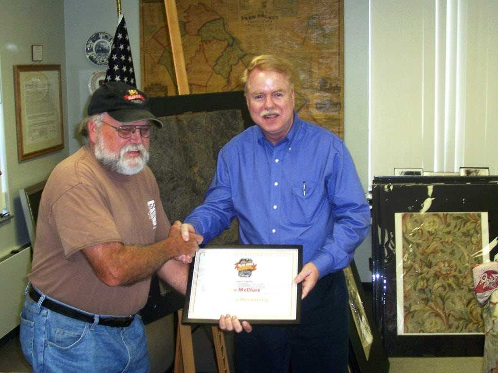 At a 2014 meeting of the Glen Rock Historic Preservation Society, Jim McClure, editor of the York Daily Record/Sunday News was presented with a certificate naming him an Honorary Member of the Glen Rock Historic Preservation Society because of his valuable contributions toward promoting the advancement of the organization, events and the town's history. GRHPS chairman, John Hufnagel , is presenting the certificate to McClure.