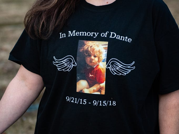 Dante Mullinix was just 2 years old when he died from serious injuries, including strangulation and suffocation. To remember him, Sarah Mullinix, his aunt, wears a shirt with Dante's picture on it.