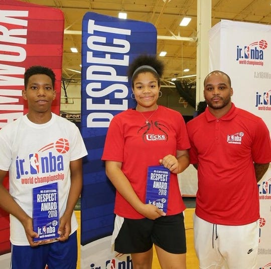 Jalen Franklin, right, poses with longtime NBA point guard Jameer Nelson and fellow youth player Delaney Locke after winning the Mid-Atlantic Respect Award at the Jr. NBA World Championship in June 2018.