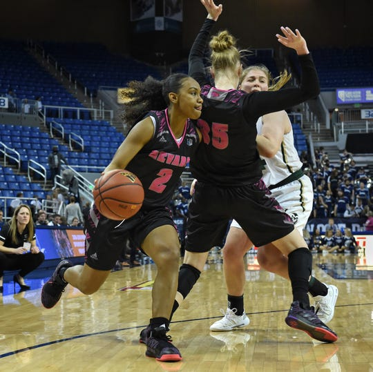 Nevada's Kristin Dearth sets up a screen against Colorado's Mollie Mounsey as Nevada's Da'Ja Hamilton to drives to the basket during Wednesday's game at Lawlor Events Center on Feb. 6, 2019.