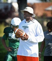 Hug varsity football coach Carl LaGrone watches his team during practice on Aug. 18, 2015.