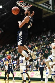 Nevada Wolf Pack forward Caleb Martin (10) finishes off a basket in the second half against the Colorado State Rams at Moby Arena.
