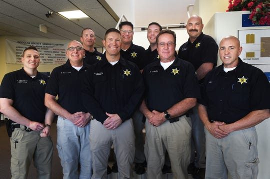 Douglas County Sheriff's investigators pose for a portrait at their headquarters in Minden on Jan. 31, 2019. Back row, left to right,  Investigators Kevin Freeman, Scott Battcher, Ryan Young and Investigations Sergeant Brian Hubkey. In the front row, left to right, Investigator Brandon Williamson, Deputy Kevin Karosich, Sheriff Dan Coverley, Deputy Steven Schultz and Under Sheriff Ron Elges.  Not shown: Not Pictured:  Evidence Technicians Debra Schambra, Christy Bateman, Investigator Ed Garren, Investigations Captain Dan Britton, Sergeant Nadine Chrzanowski.