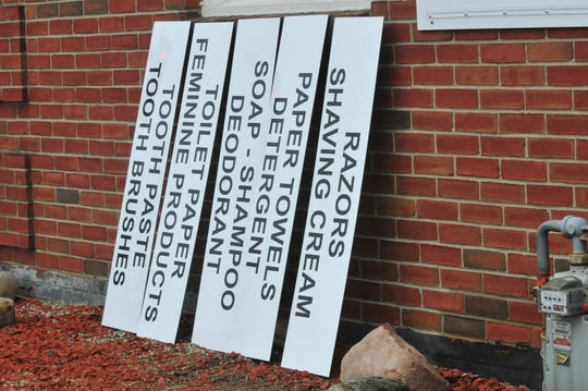 Placards indicating needs for the Salvation Army soap pantry are part of Brandon Mooney's Eagle Scout project.