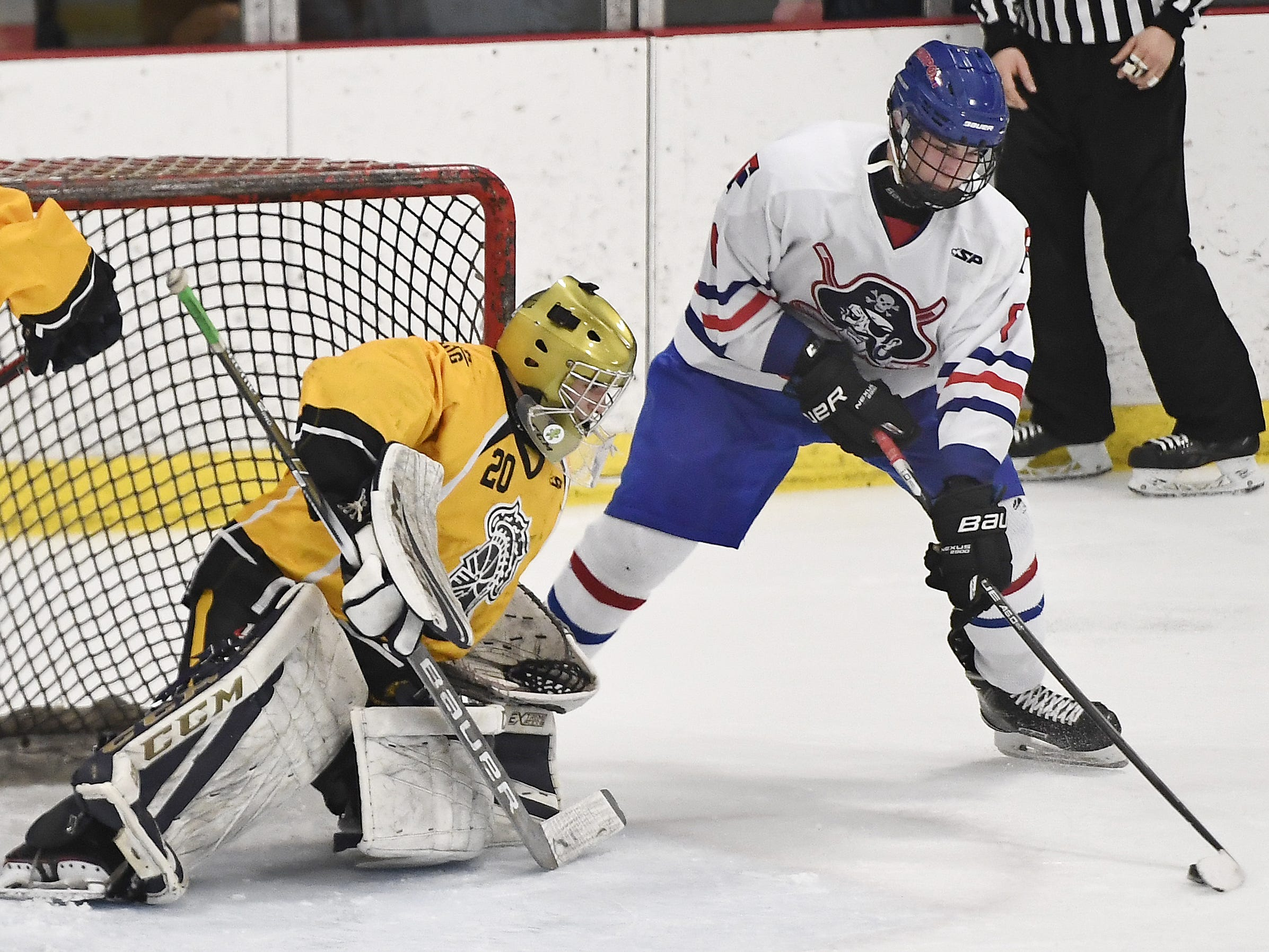 McQuaid goalie David Battisti, left, blocks a shot by Fairport's Hunter McDonald during the second period of a regular season game played at the Rochester Ice Center, Wednesday, Feb. 6, 2019. McQuaid beat Fairport 5-4 in overtime.