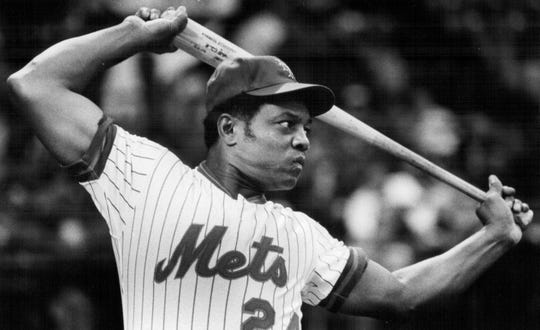 Willie Mays limbers up before going to bat during a home run hitting contest with Frank Robinson in Rochester in 1978.