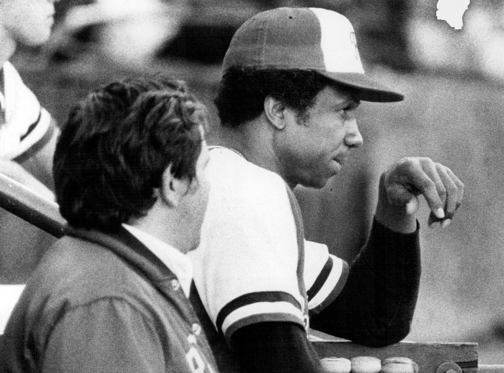 Manager Frank Robinson watches from the Rochester Red Wings dugout in 1978.
