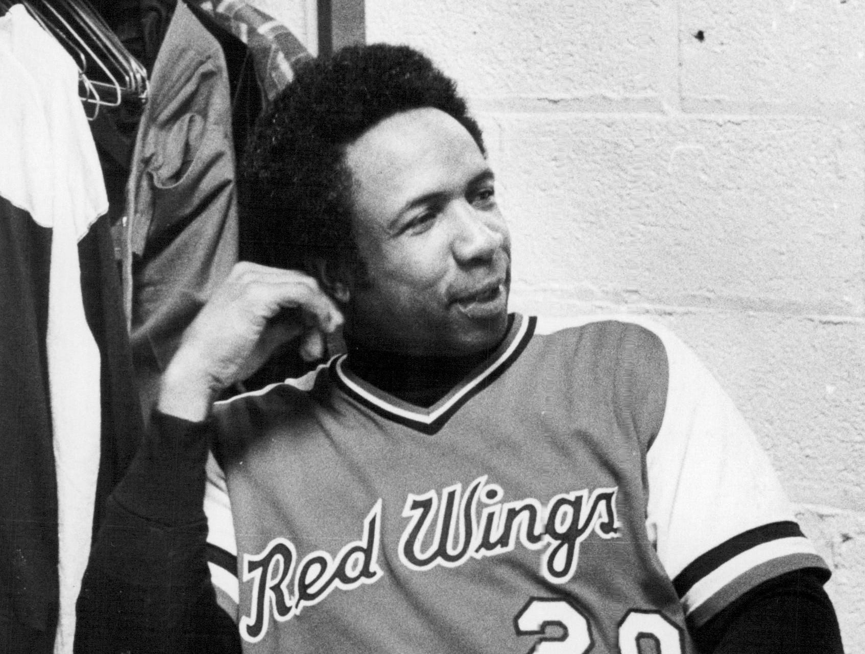 Rochester Red Wings manager Frank Robinson chats with reporters after a game in 1978.