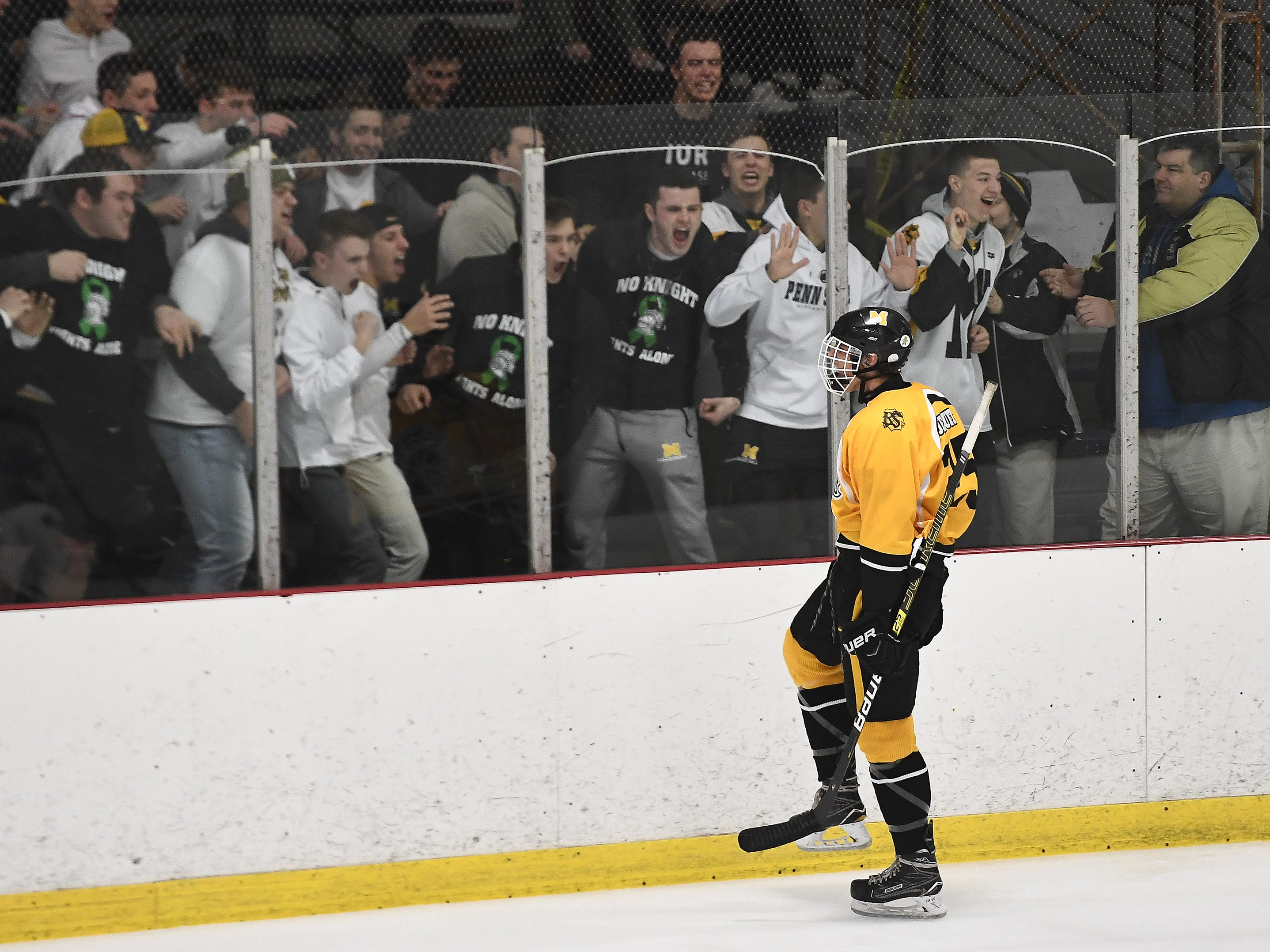 McQuaid's Quinn Tata celebrates with fans after scoring the Knights' third goal during the second period of a regular season game against Fairport played at the Rochester Ice Center, Wednesday, Feb. 6, 2019. McQuaid beat Fairport 5-4 in overtime.