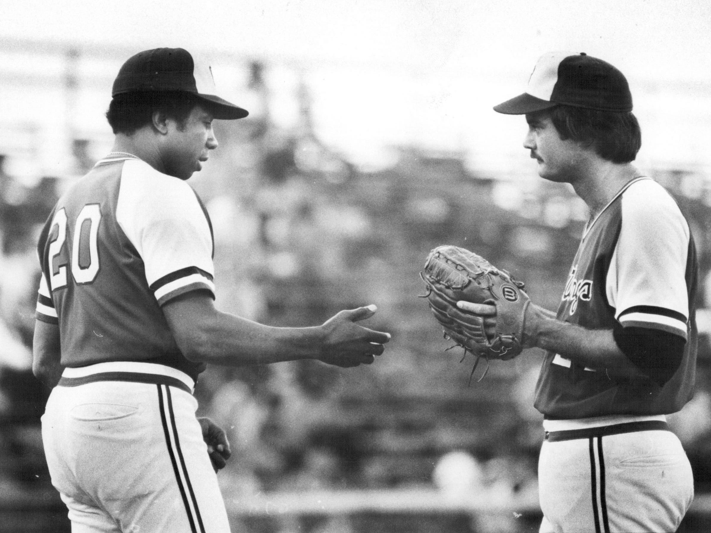Rochester Red Wings manager Frank Robinson asks for the ball as he removes Ray Bare from a game in 1978.