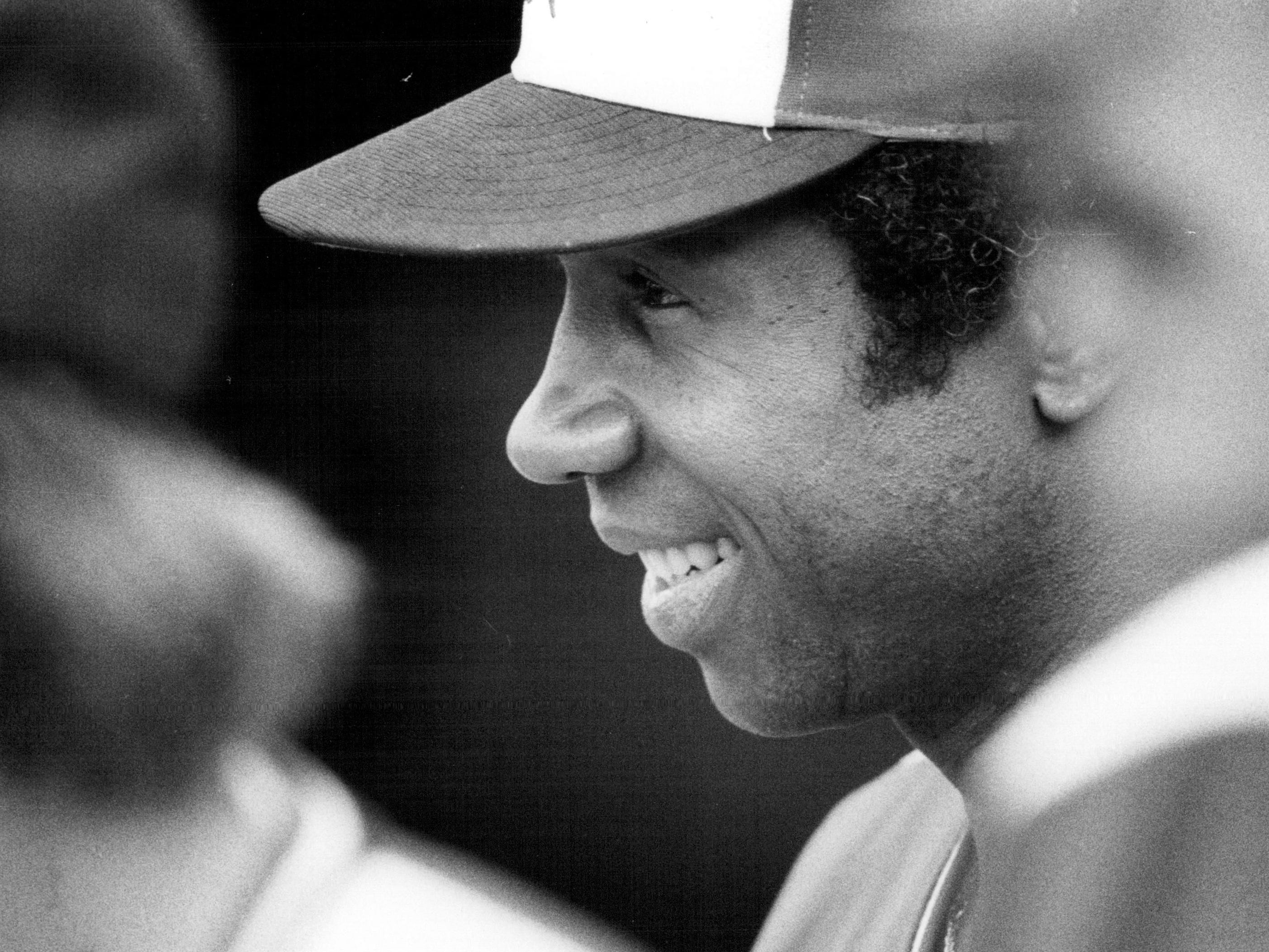 Rochester Red Wings manager Frank Robinson smiles in the dugout in 1978.