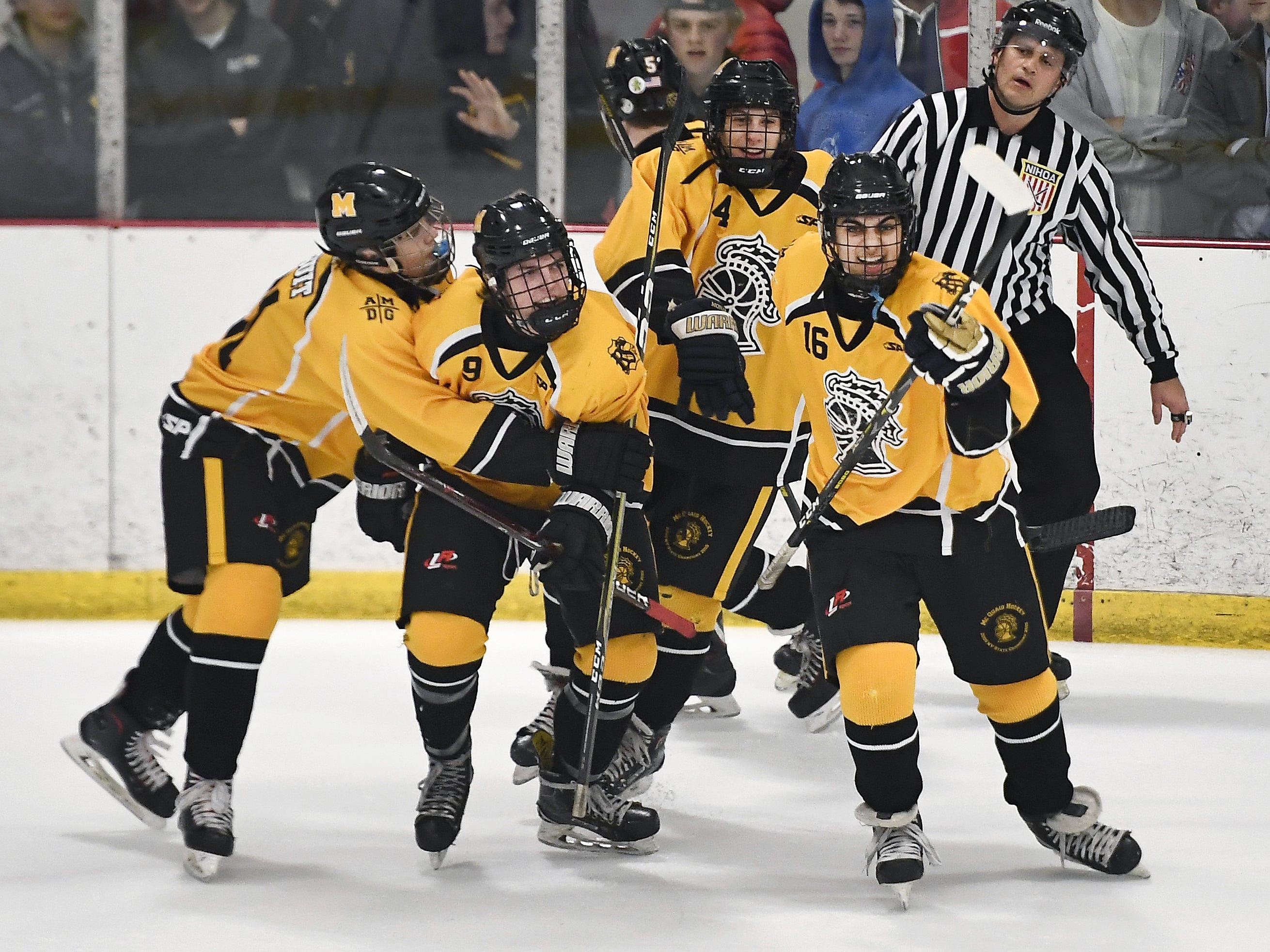 McQuaid's Zack Allen, second from left, celebrates his goal with teammates during the first period of a regular-season game played at the Rochester Ice Center, Wednesday, Feb. 6, 2019. McQuaid beat Fairport 5-4 in overtime.