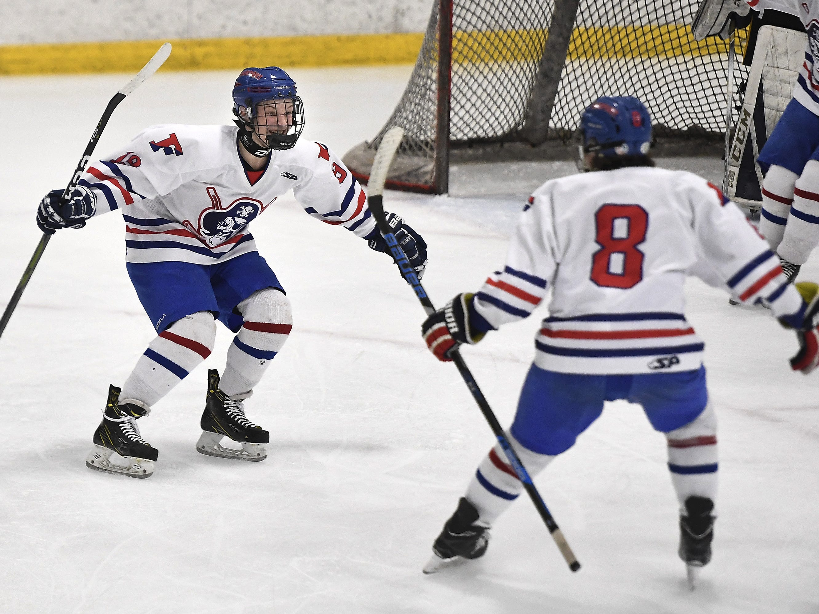 Fairport's Cory Foster, left, celebrates scoring the Raiders' second goal with teammate Matt Krug during the second period of a regular season game played at the Rochester Ice Center, Wednesday, Feb. 6, 2019. McQuaid beat Fairport 5-4 in overtime.