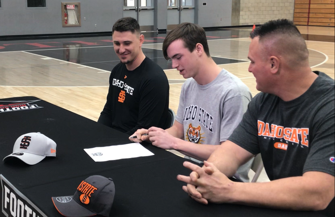 Foothill senior Jayden Gordon signs his letter of intent to play football at Idaho State on Wednesday, Feb. 6, flanked by his father, Jason Gordon (right), and his step father, Tommy Savasta.