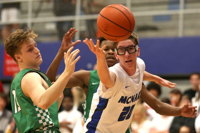 McNary's Noah Hudkins (20) and West Salem's Anthony Pugh (13) struggle for the ball during the McNary boys basketball vs. West Salem game at McNary High School in Keizer on Wednesday, Feb. 6, 2019.