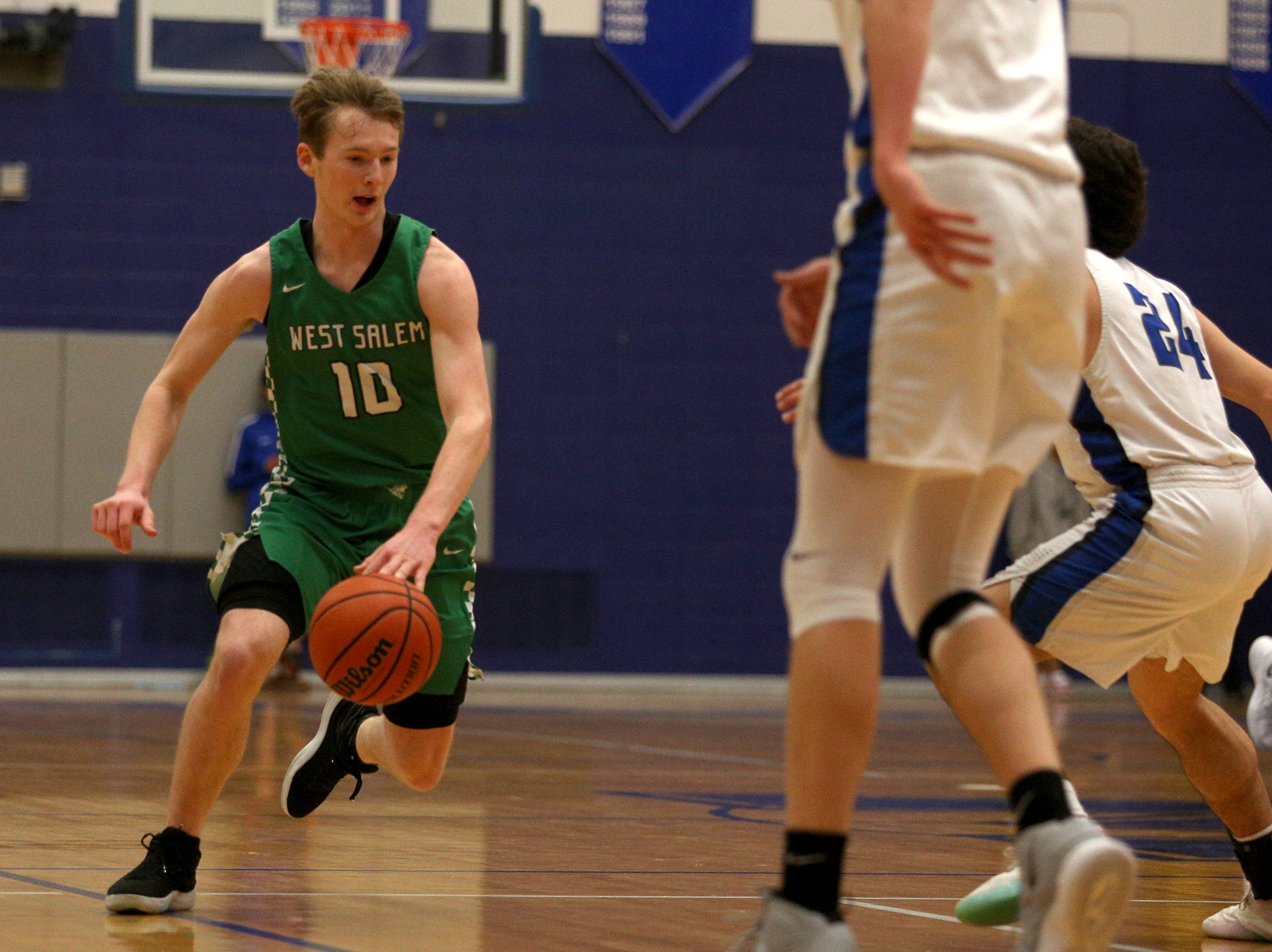 West Salem's Justin Scoggin (10) dribbles during the McNary boys basketball vs. West Salem game at McNary High School in Keizer on Wednesday, Feb. 6, 2019.