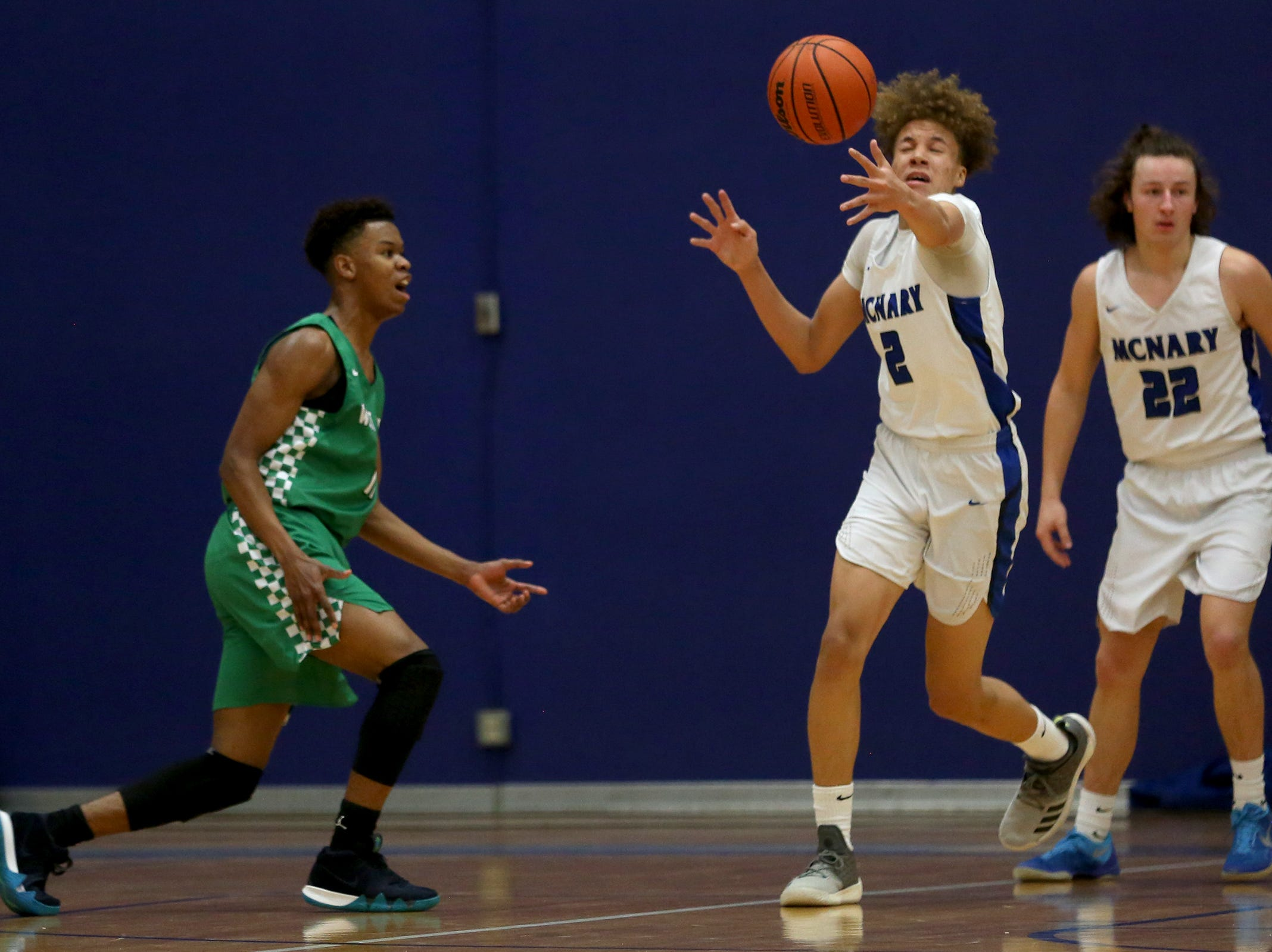 McNary's Nate Meithof (2) attempts to gain control of the ball during the McNary boys basketball vs. West Salem game at McNary High School in Keizer on Wednesday, Feb. 6, 2019.