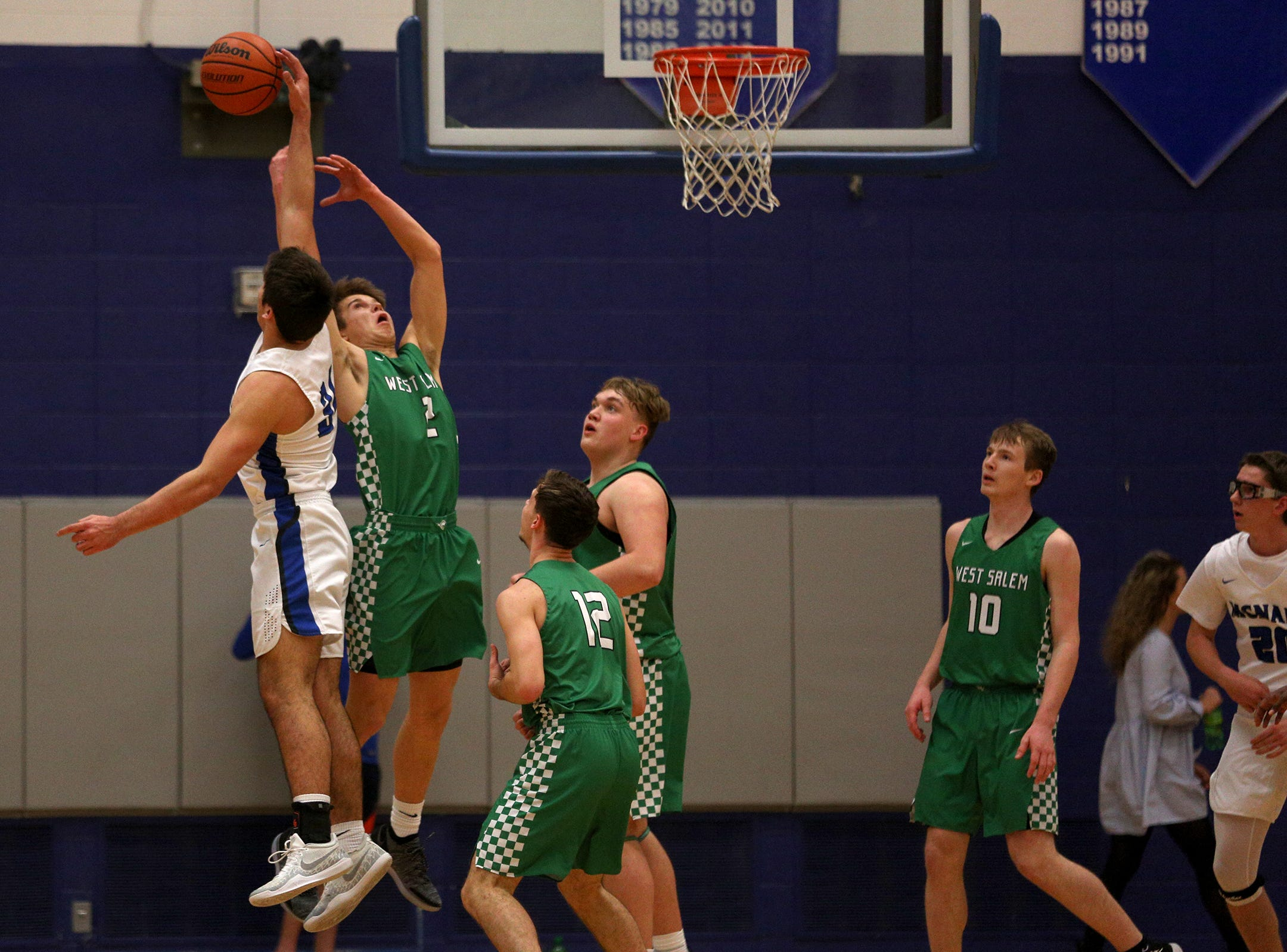 McNary's Boston Smith (30) takes control of the ball during the McNary boys basketball vs. West Salem game at McNary High School in Keizer on Wednesday, Feb. 6, 2019.