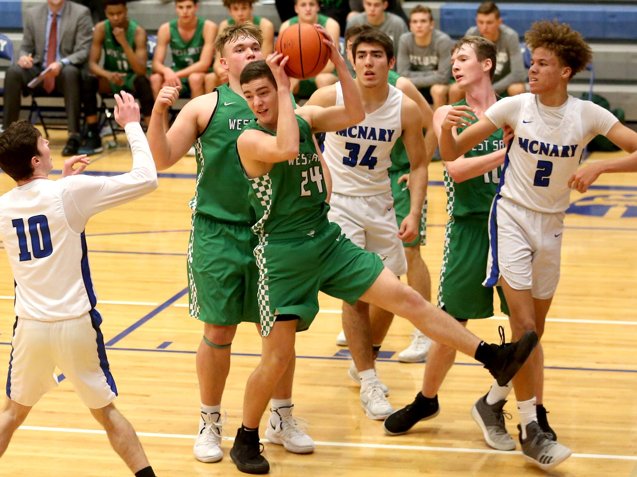 West Salem's Jackson Lowery (24) rebounds the ball during the McNary boys basketball vs. West Salem game at McNary High School in Keizer on Wednesday, Feb. 6, 2019.