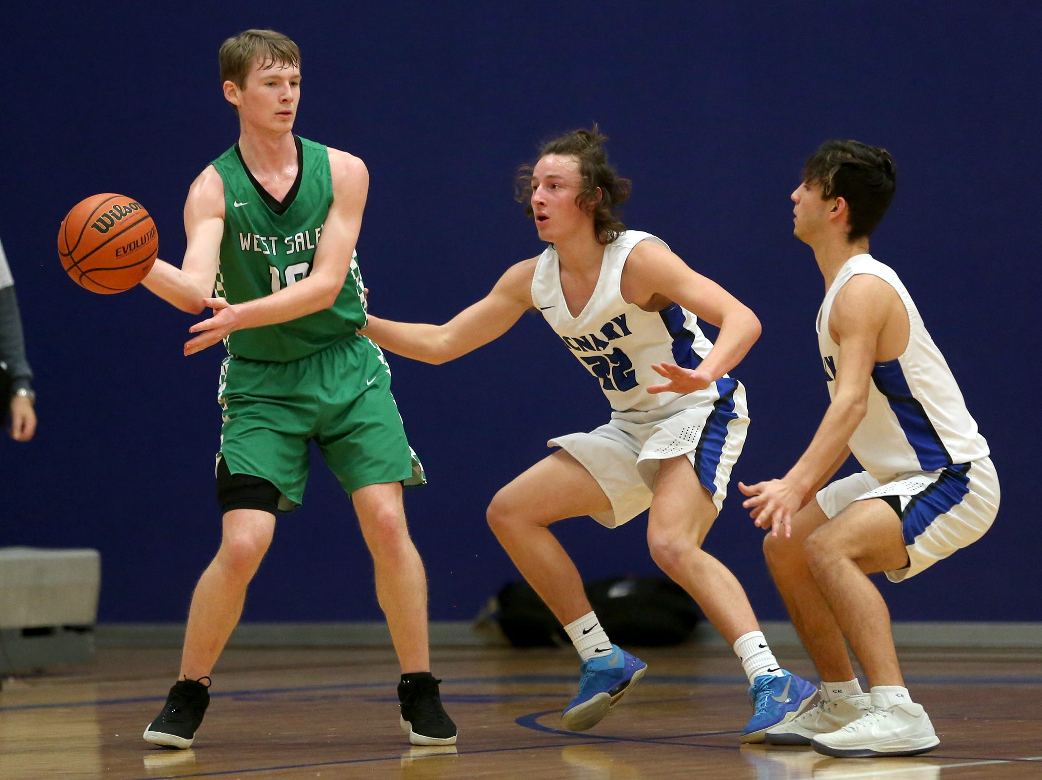 West Salem's Justin Scoggin (10) makes a pass around McNary's defense during the McNary boys basketball vs. West Salem game at McNary High School in Keizer on Wednesday, Feb. 6, 2019.