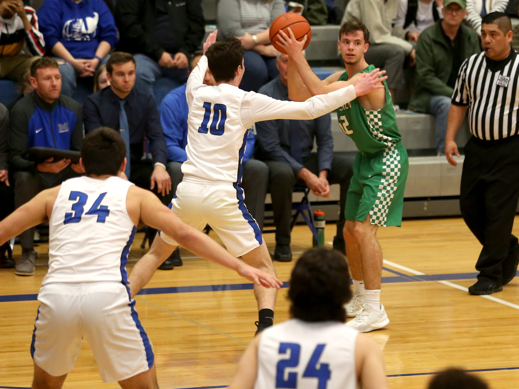 West Salem's Kieran Pruett (12) looks to make a pass during the McNary boys basketball vs. West Salem game at McNary High School in Keizer on Wednesday, Feb. 6, 2019.