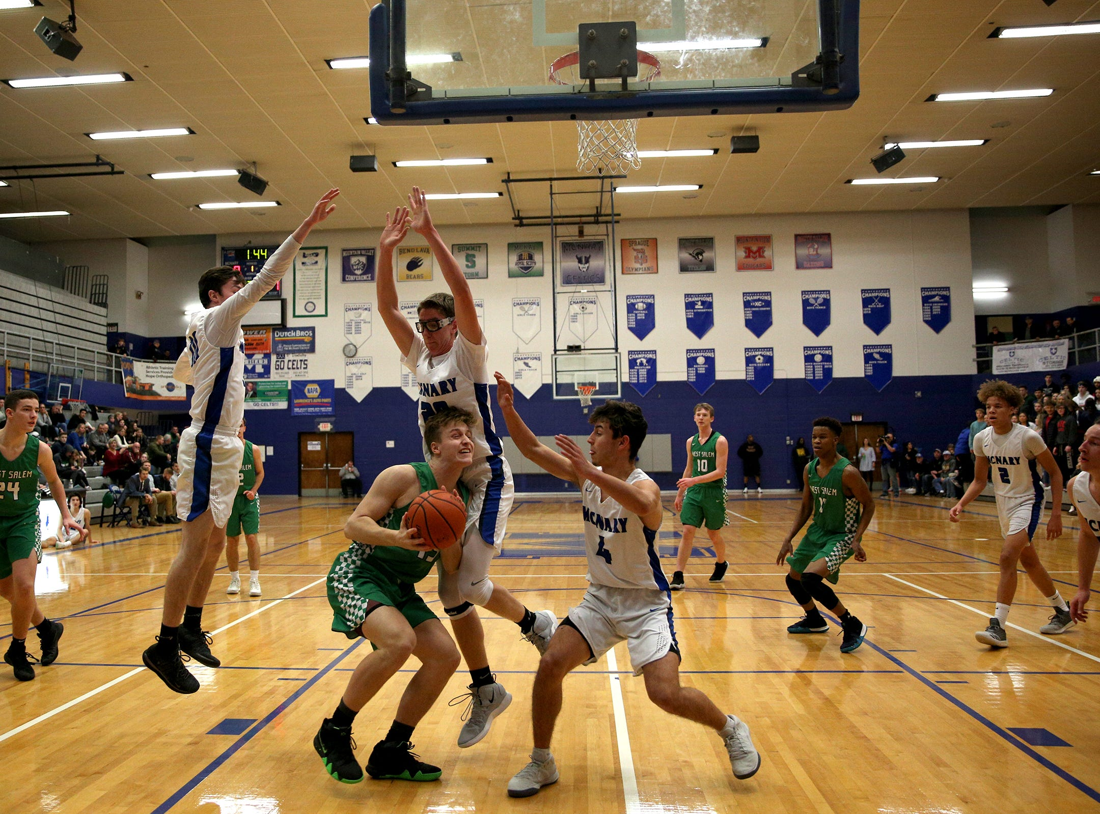 West Salem's Anthony Pugh (13) protects the ball during the McNary boys basketball vs. West Salem game at McNary High School in Keizer on Wednesday, Feb. 6, 2019.