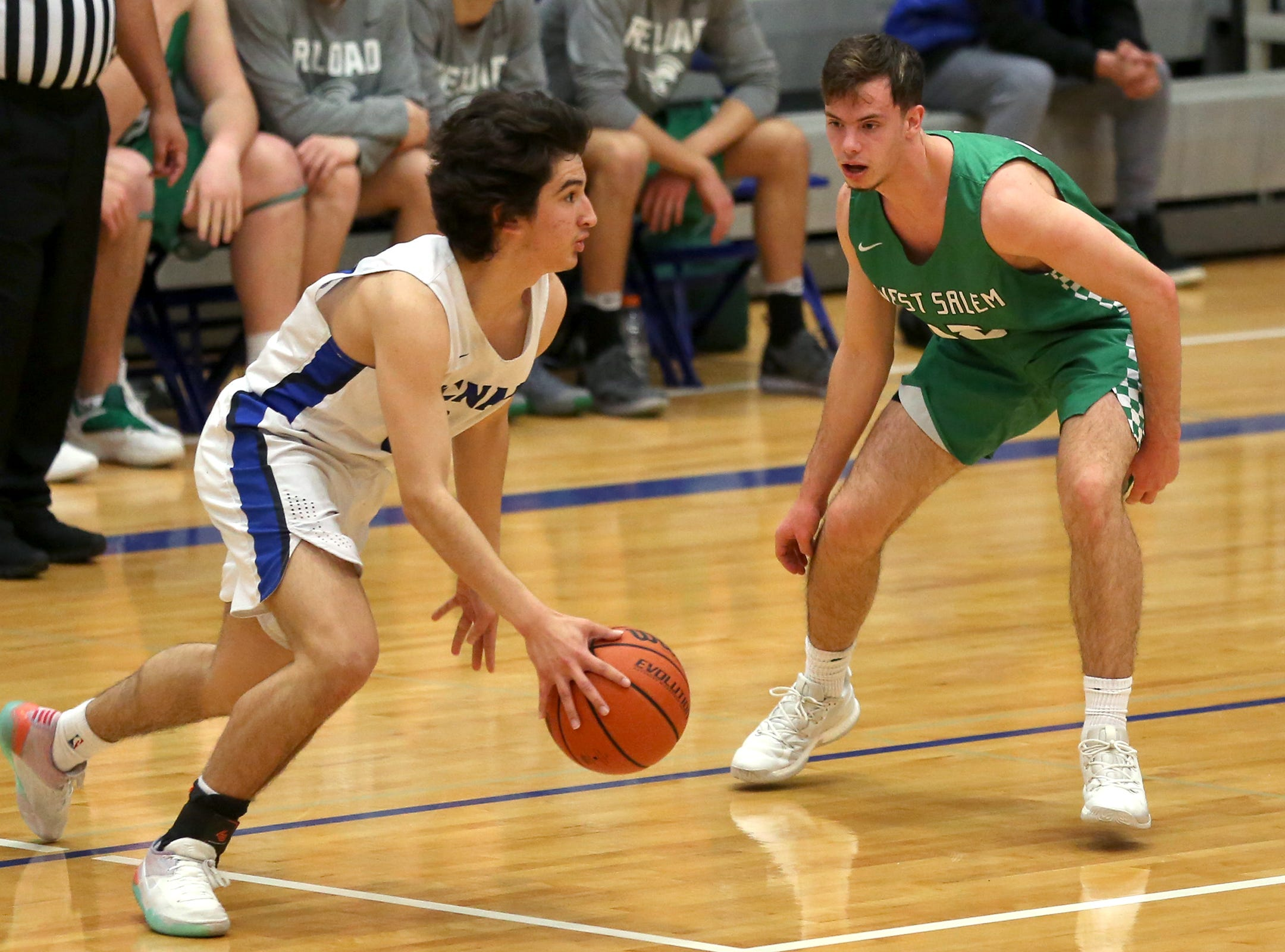 McNary's Alfredo Villareal (24) dribbles during the McNary boys basketball vs. West Salem game at McNary High School in Keizer on Wednesday, Feb. 6, 2019.